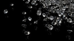Diamonds on black background with space for text.